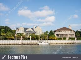 100 Boat Homes Residential Architecture Two Large Coastal Homes With A Small Boat Tied To Pier