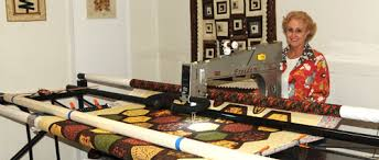 HeartSong Quilts offers longarm machine quilting services using an
