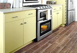 Kitchen Floor Tile Pictures Light Tone Planks Of Wood Look Flooring In A Bathroom