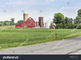Old Red Barn Silos Stands Along Stock Photo 447332473 - Shutterstock Red Barn Green Roof Blue Sky Stock Photo Image 58492074 What Color Is This Bay Packers Barn Minnesota Prairie Roots Pfun Tx Long Bigstock With Tin Photos A Stately Mikki Senkarik At Outlook Farm Wedding Maine Boston 1097 Best Old Barns Images On Pinterest Country Barns Photograph The Palouse Or Anywhere Really Tips From Pros Vermont Weddings 37654909