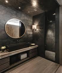 modernes designer badezimmer in schwarz runder spiegel