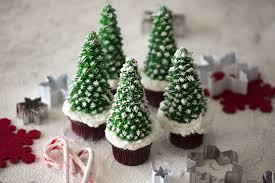 A Photo Of Christmas Cupcakes With Trees On Top