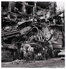 People in front of the remains of the Central Post fice where