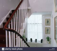 Mahogany Rail And White Banisters On White Staircase Stock Photo ... Contemporary Stair Banisters How To Replace Banister Stair Banister Rails The Part Of For What Is A On Stairs Handrail Code For And Guards Stpaint An Oak The Shortcut Methodno Architecture Inspiring Handrails Beautiful 25 Best Steel Handrail Ideas On Pinterest Remodelaholic Diy Makeover Using Gel Stain Wood Railings Best Railing Amazoncom Cunina 1 Pcs Fit 36 Inch Baby Gate Adapter Kit Michael Smyth Carpentry