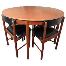 Vintage Teak Foldout Dining Table 4 Chairs By Tom Robertson For McIntosh,  1960 Ding Room Fniture Cluding A Table Four Chairs By Article With Tag Oval Ding Tables For 8 Soluswatches Ercol Table And Chairs Elm 6 Kitchen Room Interior Design Vector Stock Rosewood Set Extendable Whats It Worth Find The Value Of Your Inherited Fniture Wikipedia Danish Teak Wood Chairs Circa 1960 Set How To Identify Genuine Saarinen Table Scandart Vintage Mid Century S Golden Elm Extending 4