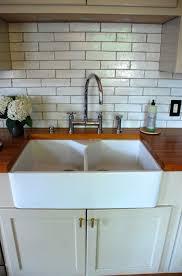 Image Of Farmhouse Kitchen Sink With Backsplash