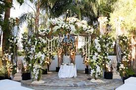 Wedding Flower Arch With Branches Green Leaves White Roses And Orchids