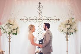 June Indoor Wedding With Cross Backdrop