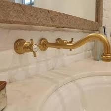 wall mount vintage antique brass gooseneck faucet over bathroom