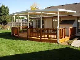 Deck Roof Cover Ideas In Old Wooden Also Wooden Louvered Patio ... Backyard Landscaping House Design With Deck And Patio Plus Wooden Difference Between Streamrrcom Decoration In Designs Nice Outdoor 3 Grabbing Exterior Beauty With Small Ideas Newest Home Timedlivecom 4 Tips To Start Building A Deck Designs Our Back Design Very Cost Effective Used Conduit Natural Burlywood Awesome Entrancing Pretty Designer Software For And Landscape Projects Depot Choosing Or Suburban Boston Decks Porches Blog Amazing Of Decorate Your