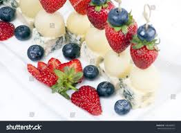 berry canapes canapes on plate cheese melon strawberries stock photo 148686893