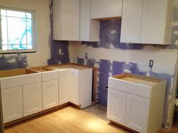Red Oak Wood Autumn Windham Door Hampton Bay Kitchen Cabinets Backsplash Herringbone Tile Marble Quartz Countertops