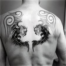 Tribal Dragon Tattoo Design On Males Back