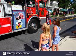 Girls Looking At Fire Truck With Mickey Mouse On The Side, 4th Of ... Mickey Mouse Firetruck Cake Hopes Sweet Cakes Firetruck Wall Decals Gutesleben Kiddieland Disney Light And Sound Activity Rideon Clubhouse Toy Lot Fire Truck Airplane Car Figures Melissa Doug Friends Wooden Zulily Police Clipart Astronaut Pencil In Color Mickey Mouse Toys Hobbies Find Products Online At Amazoncom Mickeys Farm Vehicles Jual Takara Tomy Tomica Dm11 Jolly Float Figure Disneyland Vintage