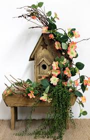 Country Floral Incorporated Into Rustic Birdhouse Flowers
