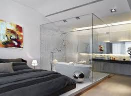 a contemporary bedroom with an attached glass bathroom and