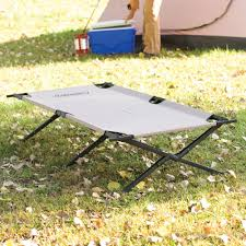 Trailhead™ II Cot | Coleman Ez Funshell Portable Foldable Camping Bed Army Military Cot Top 10 Chairs Of 2019 Video Review Best Lweight And Folding Chair De Lux Black 2l15ridchardsshop Portable Stool Military Fishing Jeebel Outdoor 7075 Alinum Alloy Fishing Bbq Stool Travel Train Curvy Lowrider Camp Hot Item Blue Sleeping Hiking Travlling Camping Chairs To Suit All Your Glamping Festival Needs Northwest Territory Oversize Bungee Details About American Flag Seat Cup Holder Bag Quik Gray Heavy Duty Patio Armchair