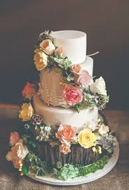 A Woodland Inspired Wedding Cake Crawling With Sugar Flowers