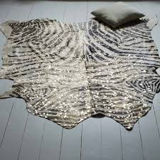 Zebra Print Bathroom Accessories Uk by Metallic Zebra Cowhide Rug Rug Designs