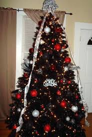 Red Artificial Christmas Trees And Silver Ornaments On The Tuxedo Black Tree Mini
