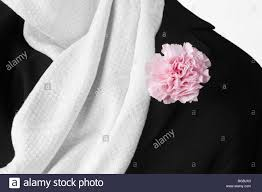 close up of white silk scarf and black jacket stock photo royalty