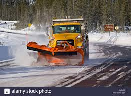 A Snow Plow And Sanding Truck Clears A Mountain Highway Of Snow ... Snow Plow Truck Stock Images 824 Photos Pick Up Download Free Vector Art Graphics Toy For Kids Youtube Penn Turnpike Mack Tandem Plow And Is This A Glimpse At The Future Of Snow Removal In Ottawa City Illustration Pickup 358461824 Truck Living Sustainable Dream Clearing Road After Photo 644609866 Choosing Right This Winter 1997 Ford F350 4x4 Western Sold Wkhorse Plowing Landscaping