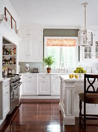 Opting For Refined And Simple This Kitchen Is Outfitted With Classic White Cabinets Countertops Crafted From Honed Statuary Marble Random Gray