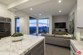 View Of The Living Space From Kitchen Showcasing Kitchens Marble Countertop