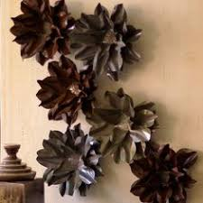 Metal Flower Wall Accent In Rustic Finish