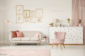 pink living room with posters stock photo image now