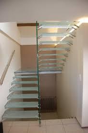 escalier verre quart tournant avec palier verre et grade corps