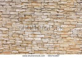 Rock Stone Brick Tile Wall Aged Texture Detailed Pattern Background In Light Yellow Cream Brown Color
