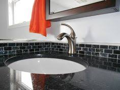 glass tile backsplash accent with blue glass sink custom marble