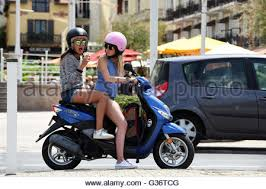 Young Teenage Girls Women On Scooter In Biarritz France