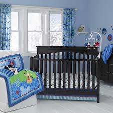 interior blue mickey mouse crib bedding on black wooden crib