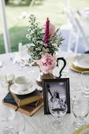Wine Bottle And S Vintage Wedding Centerpieces With Books Milk Glass Love These Colorful