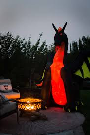 Halloween Yard Inflatables by Styling A Fire Themed Halloween Porch With A Dragon Yard Inflatable