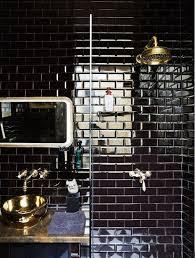 black subway tiles gold fixtures and vessel sink bathroom design