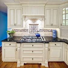 Kitchen Backsplash Ideas For Dark Cabinets by Best 25 White Distressed Cabinets Ideas On Pinterest Country