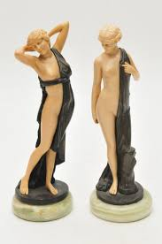 deco figurines reproductions two reproduction deco figures of semi clad in the manner