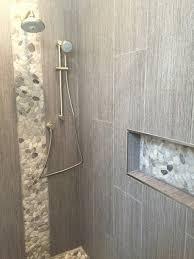 12 x 24 ceramic tiles with a decorative pebble shower niche