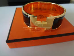 hermes clic clac bracelet black and gold 690 0000