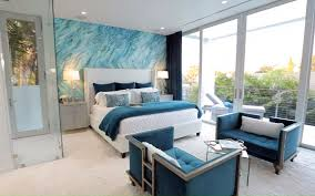Teal Bedroom With Accent Wall Sitting Area Furniture And Balcony