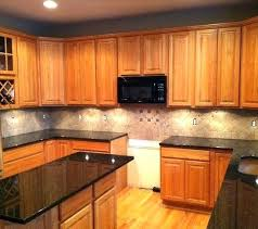 granite countertops with oak cabinet light colored oak cabinets