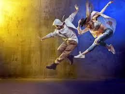 Stylish Dancers Dancing In A Concrete PlaceKonrad Bk