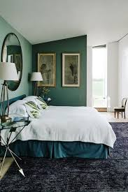 A Modern Bedroom With Teal And White Walls Black Carpet Large Convex