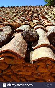 clay roof tiles aged arabic style in spain perspective stock