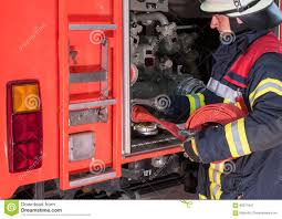 Firefighter In Action Connected A Fire Hose On The Fire Truck Stock ... Truck Firefighters Hose Firemen Blaze Fire Burning Building Covers Bed 90 Engine A Firetruck Stock Photos Images Alamy Hose Pipe And Truck Vector Image 1805954 Stockunlimited American Fire With Working V10 Modhubus National Reel Kids Pedal Filearp2 Zis150 Engine Tender Frontleft Viewjpg Los Angeles Department 69 An Attached Flickr Fire Truck Photo Unique Crown Wagon Filenew York City Fighter Pulling Water From