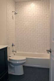 Bathroom With Herringbone Pattern White Subway Tile Surround And ... Beautiful Ways To Use Tile In Your Bathroom A Classic White Subway Designed By Our Teenage Son Glass Vintage Subway Tiles 20 Contemporary Bathroom Design Ideas Rilane 9 Bold Designs Hgtvs Decorating Design Blog Hgtv Rhrabatcom Tile Shower Designs Vintage Ideas Creative Decoration Shower For Each And Every Taste 25 Small 69 Master Remodel With 1 Large Mosiac Pan Niche House Remodel Modern Meets Traditional Styled Decorating