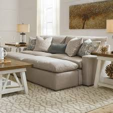 100 2 Sofa Living Room Melilla Pit Sectional With Accent Ottomans By Benchcraft At Northeast Factory Direct